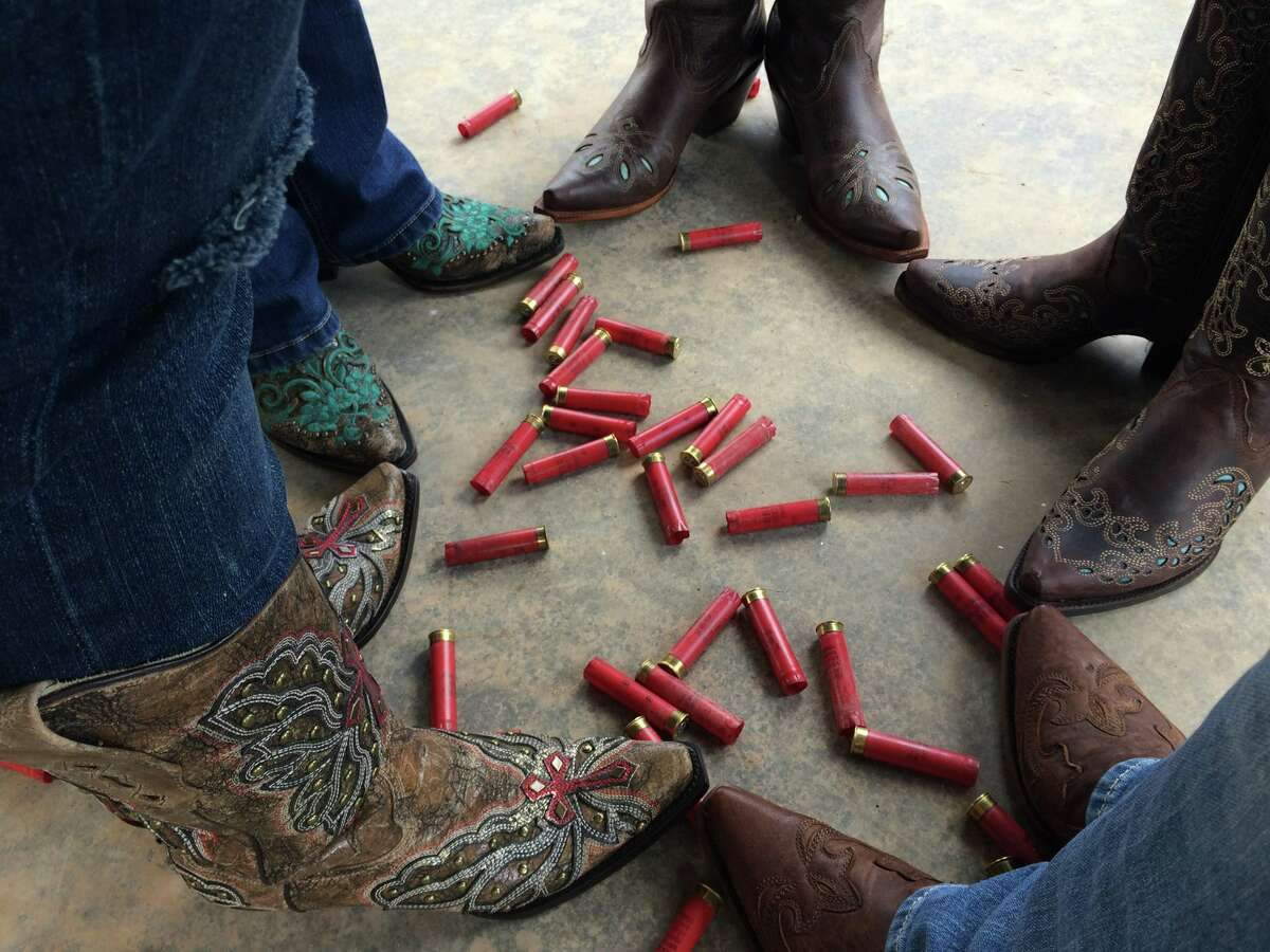 Detail shot of new boots with shells after a day spent shooting clays at Windwalker Farms.