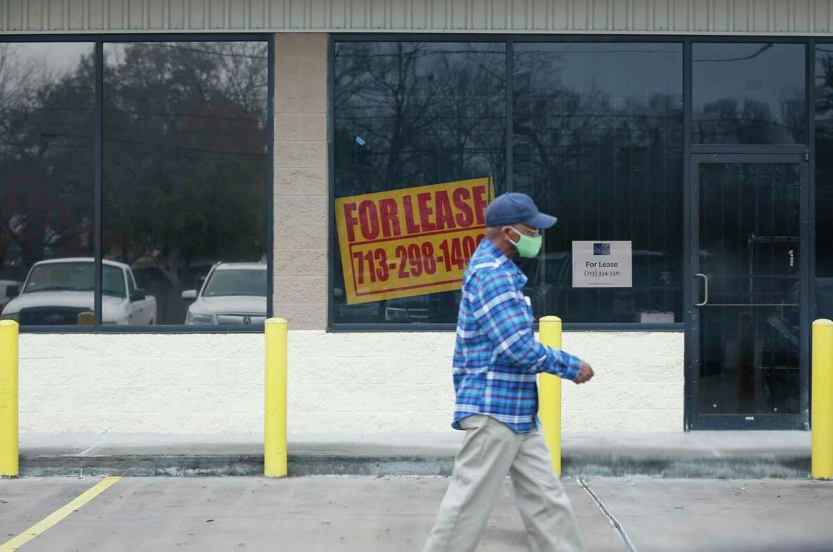 A man walks past a business that is closed in the 2600 block of Crosstimbers Street Saturday, Jan. 23, 2021, in Houston.