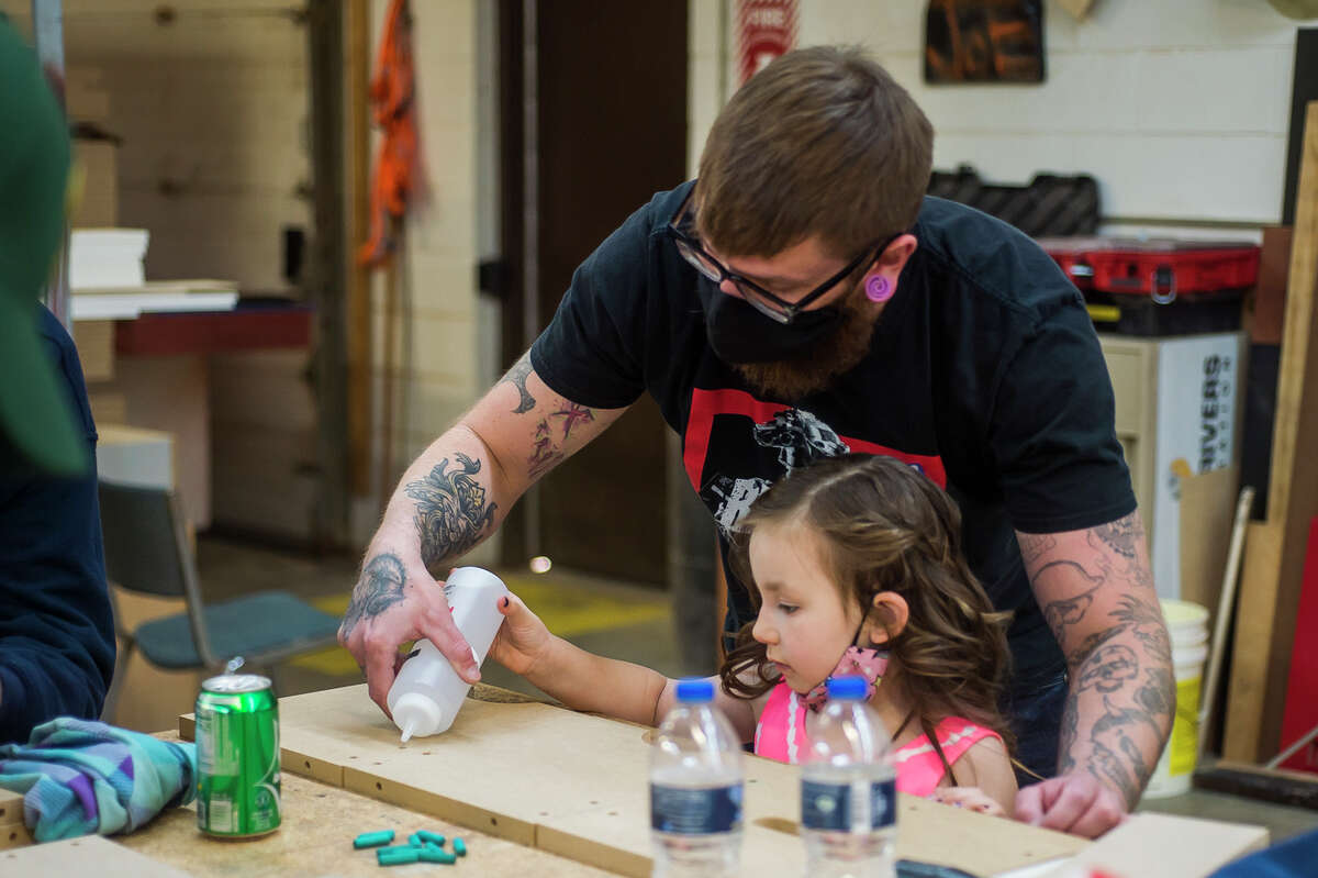 Adelynn McNett, 5, works with her dad, Ryan McNett, to build a step stool during a father and daughter event hosted by Self Love Beauty and sponsored by Three Rivers Corporation, Modern Realty, and Hemlock Semiconductor Tuesday, May 11, 2021 at Three Rivers Corporation. The pairs enjoyed a pizza dinner before working together on a STEM-based building activity and taking part in other confidence-focused activities. (Katy Kildee/kkildee@mdn.net)
