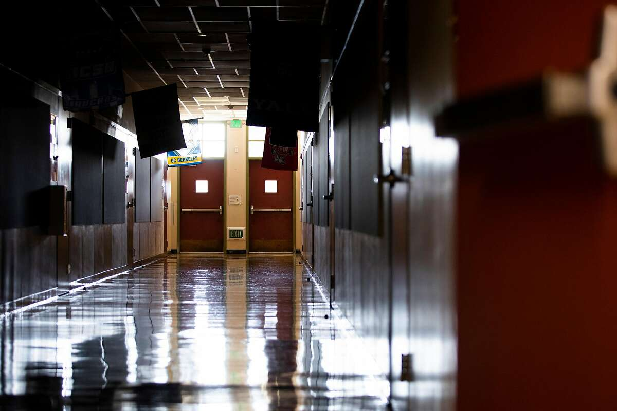 A kindergarten teacher at a school in West Contra Costa Unified, which reopened classrooms on a hybrid schedule for families who opted in, has chosen not to teach in person, and parents are asking why she's now heading to Mexico. The halls of Garfield Elementary School are seen empty ahead of reopening in Oakland on March 23.