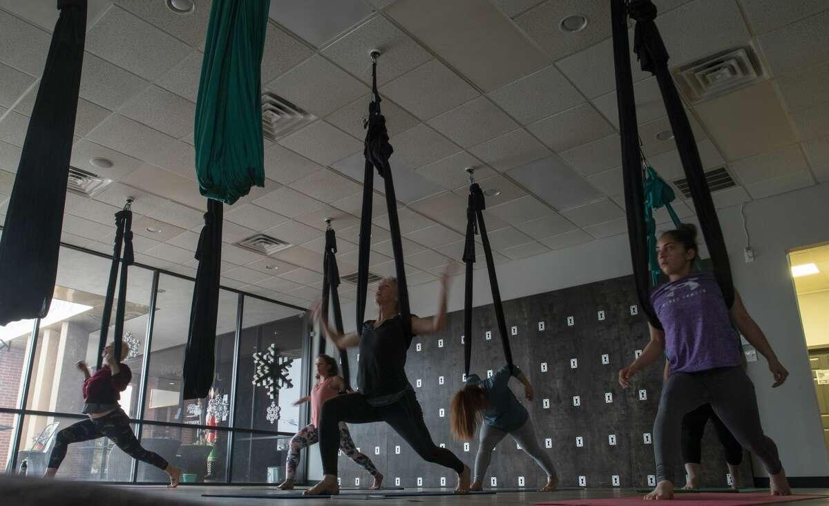 Cyndi Simpson teaches an aerial yoga class at Midland Yoga Works.