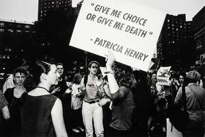 """""""Choice Aint No Joke, Union Square, N.Y.C."""" (1989) by Donna Ferrato is part of """"Of Woman Born,"""" a new exhibit at Housatonic Museum of Art exploring male dominance over women."""