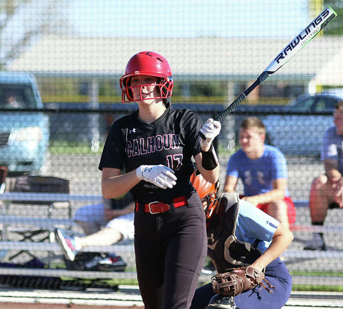 Calhoun's Elly Pohlman looks to her coach during an at-bat in an April 30 game at Jersey. On Tuesday, Pohlman's focus was on pitching during her complete-game win over Brussels in Hardin.