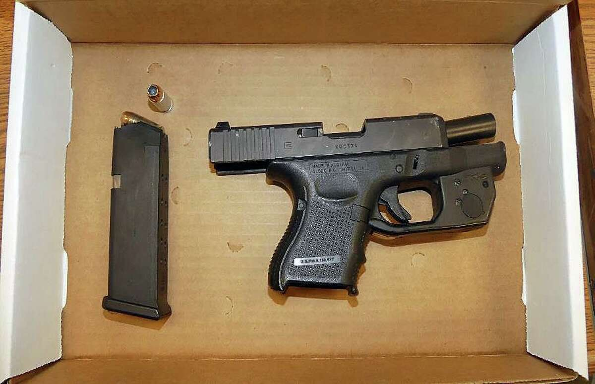 The gun police say was recovered after a chase near the Greene Homes housing complex in Bridgeport, Conn., on May 12, 2021.