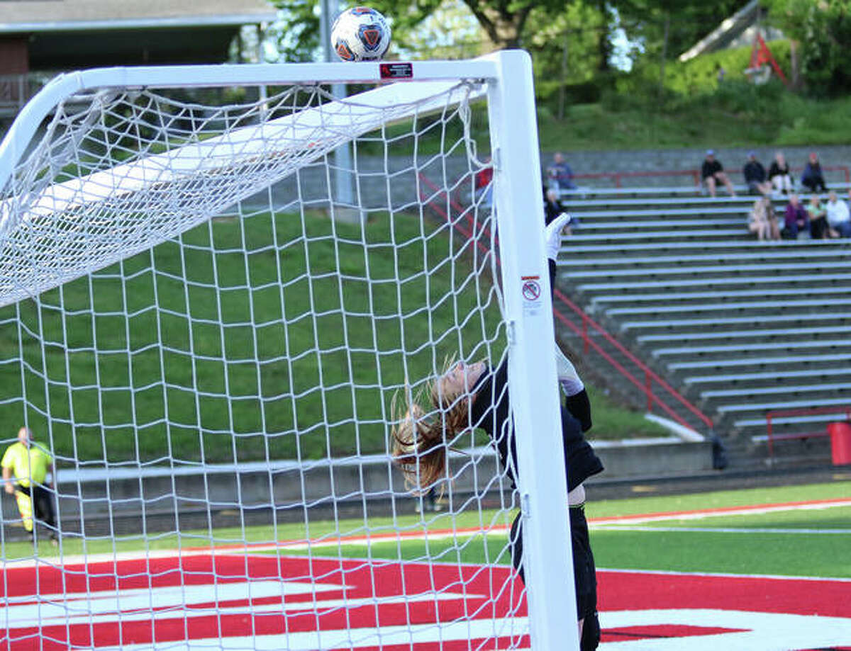 Alton goalie Addi Miller deflects a shot over the crossbar during a May 5 match against Marquette Catholic at Public School Stadium. On Tuesday at Collinsville, Miller made 11 saves in a SWC loss to the Kahoks.