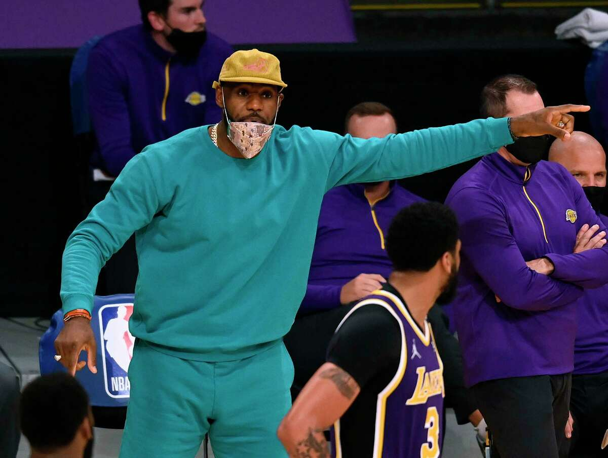 LeBron James reacts to a play during the Lakers' overtime win over the Knicks on Tuesday in Los Angeles. He's missed five straight games as the Rockets visit Staples Center on Wednesday night.