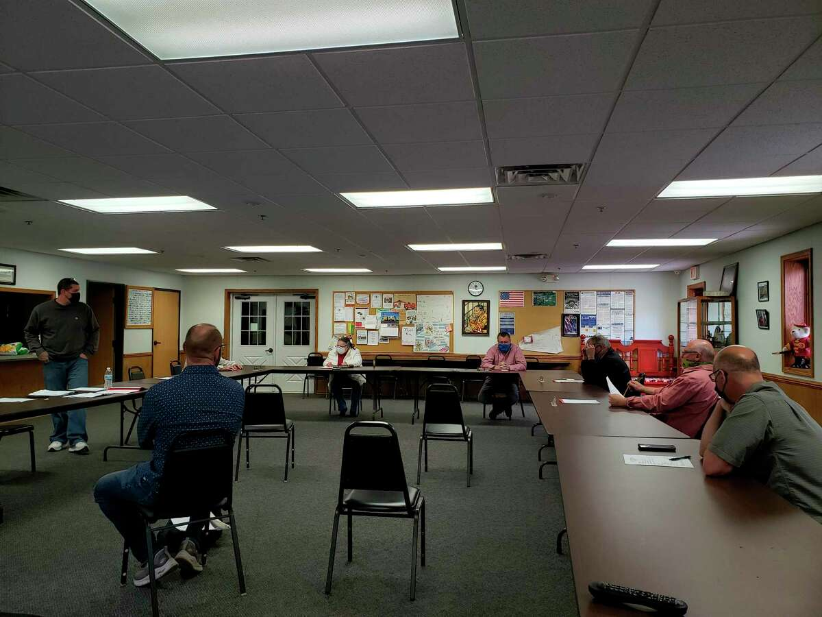 The Caseville City Council members chat before their monthly meeting this past week. (Robert Creenan/Huron Daily Tribune)