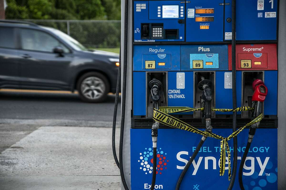 Caution tape is wrapped around fuel pumps at an Exxon Gas Station on Boonsboro Road in Lynchburg, Va., Tuesday, May 11, 2021. More than 1,000 gas stations in the Southeast reported running out of fuel, primarily because of what analysts say is unwarranted panic-buying among drivers, as the shutdown of a major pipeline by hackers entered its fifth day. In response, Virginia Gov. Ralph Northam declared a state of emergency. (Kendall Warner/The News & Advance via AP)