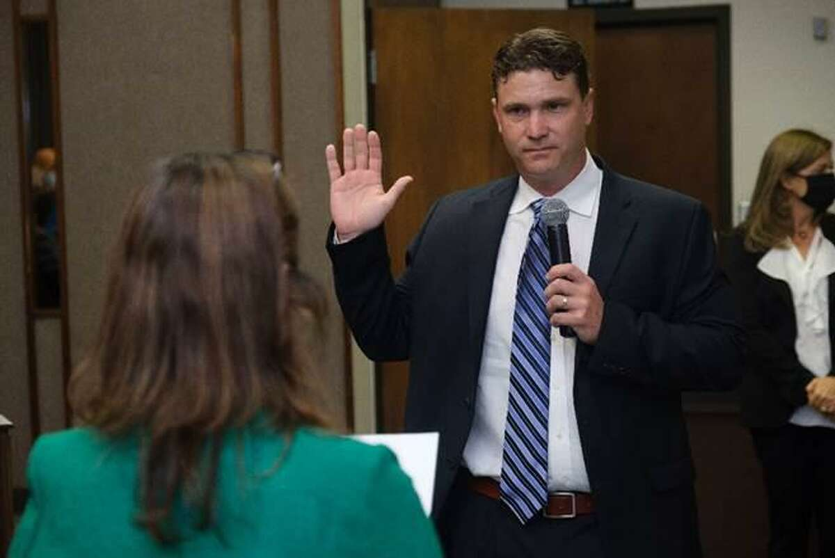 Chris Earnest, the only first-time member on the 2021-2022 Spring Branch ISD Board of Trustees, gets sworn in at a ceremony on May 11