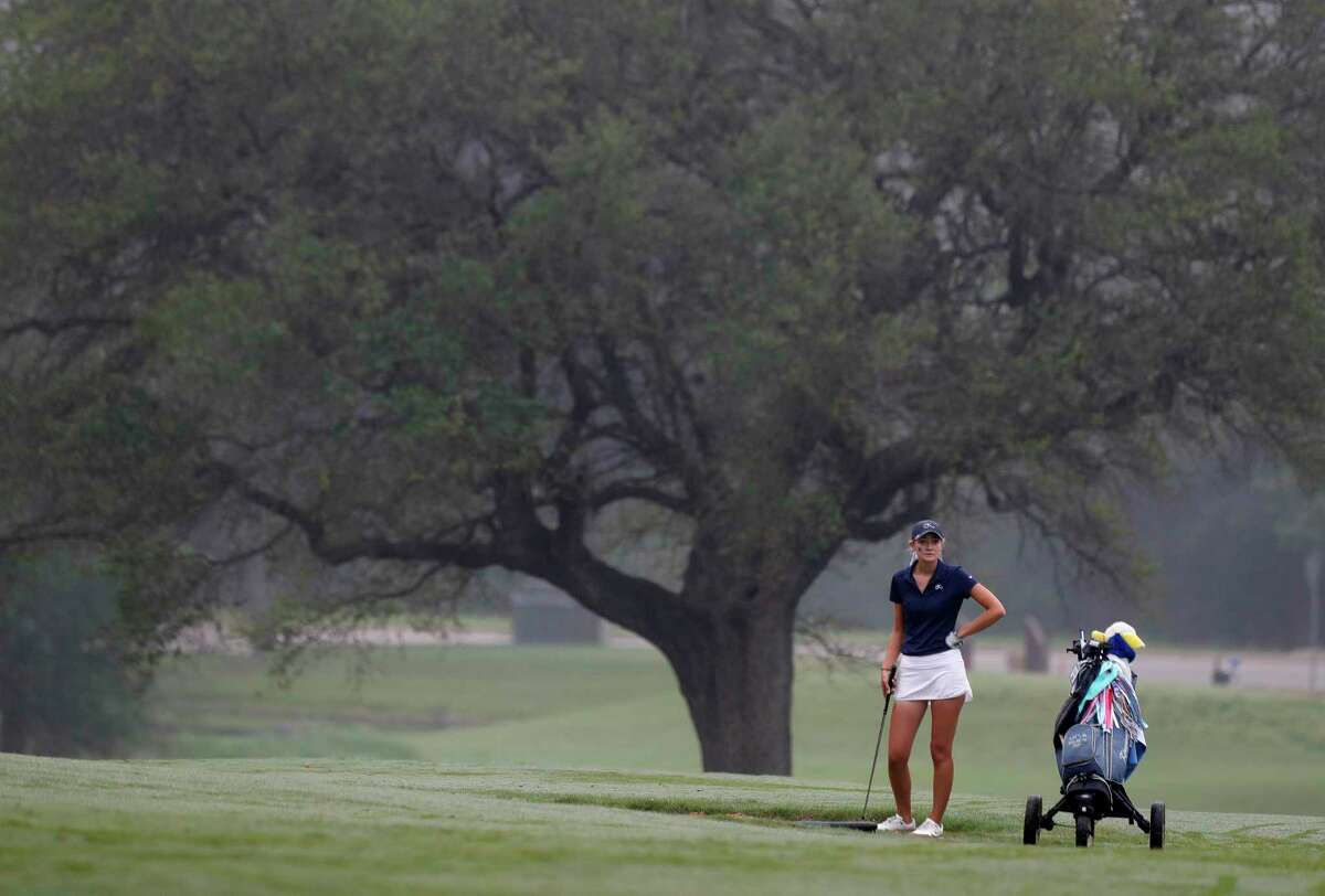 Kaetlin Halseth of Kingwood waits to hit out a bunker toward the 9th green during the Class 6A girls UIL State Golf Championship at Legacy Hills Golf Club, Tuesday, May 11, 2021, in Georgetown.