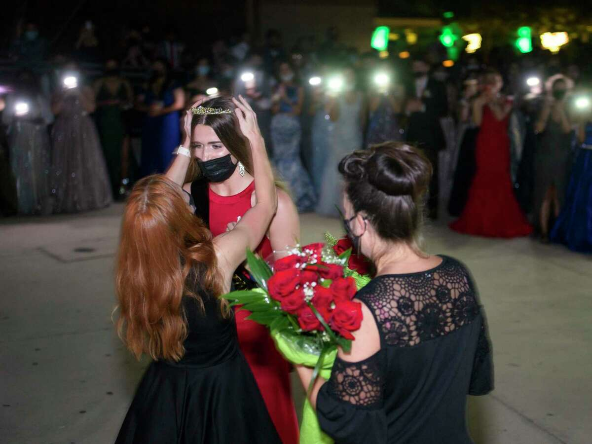 Brianna Helmke was crowned prom princess as students at East Central High School lighted up the area with their cell phones Saturday.