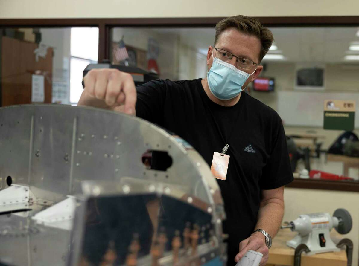 Lead mentor, Tim Grassman, assists with the building of a small aircraft during a CTE practicum course in aerospace engineering at Porter High School, Tuesday, May 12, 2021, in Porter. The school organization hopes to have the aircraft ready for flight by