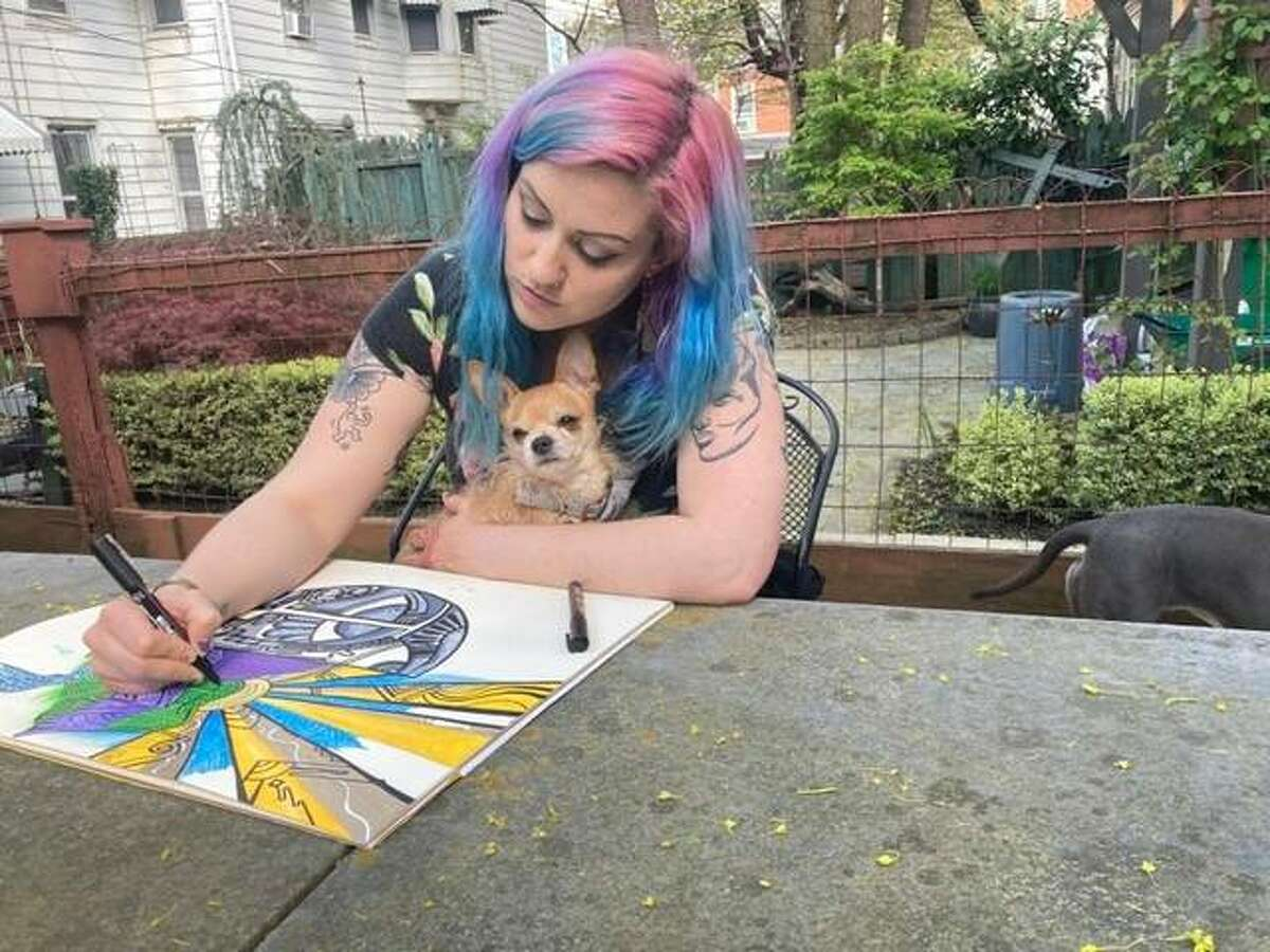"""Artist Yenna Hill drawing at her home in Reading, Pennsylvania, where her mother, Kay Haring, and uncle, the late Keith Haring, were born. Hill will have her first national solo exhibition """"Muse User"""" at Good Weather Gallery in Edwardsville May 22-June 19 and be at the opening in-person reception 6-9 p.m., Saturday, May 22."""