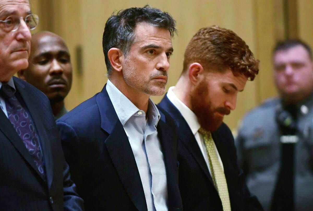 In this Jan. 8, 2020 file photo, Fotis Dulos, the estranged husband of a missing mother of five, is arraigned on murder and kidnapping charges in Stamford Superior Court in Stamford.