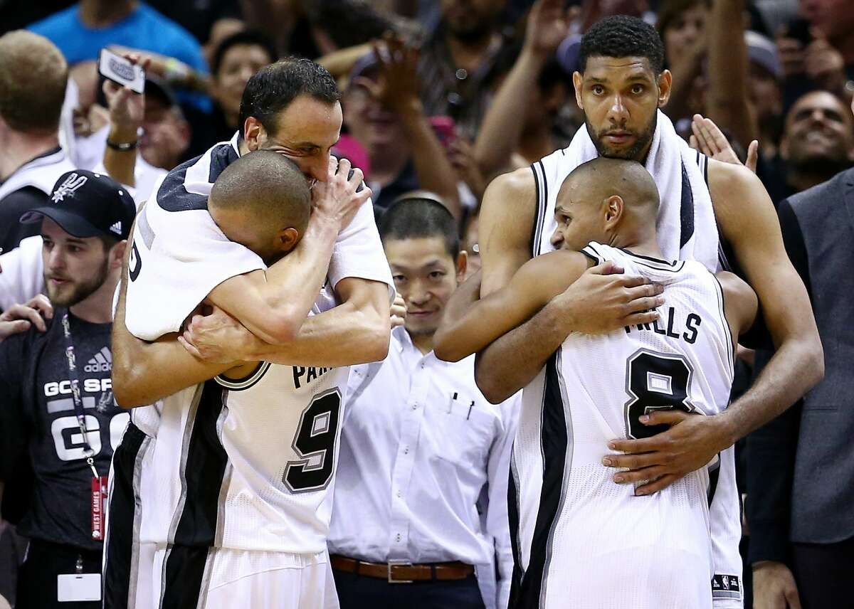 SAN ANTONIO, TX - JUNE 15: Manu Ginobili #20, Tony Parker #9, Patty Mills #8 and Tim Duncan #21 of the San Antonio Spurs celebrate on the bench in the closing minutes of Game Five of the 2014 NBA Finals against the Miami Heat at the AT&T Center on June 15, 2014 in San Antonio, Texas. NOTE TO USER: User expressly acknowledges and agrees that, by downloading and or using this photograph, User is consenting to the terms and conditions of the Getty Images License Agreement. (Photo by Andy Lyons/Getty Images)