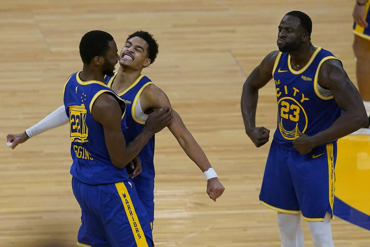 Golden State Warriors forward Andrew Wiggins, left, celebrates with guard Jordan Poole and forward Draymond Green, right, during the second half of the team's NBA basketball game against the Phoenix Suns in San Francisco, Tuesday, May 11, 2021. (AP Photo/Jeff Chiu)