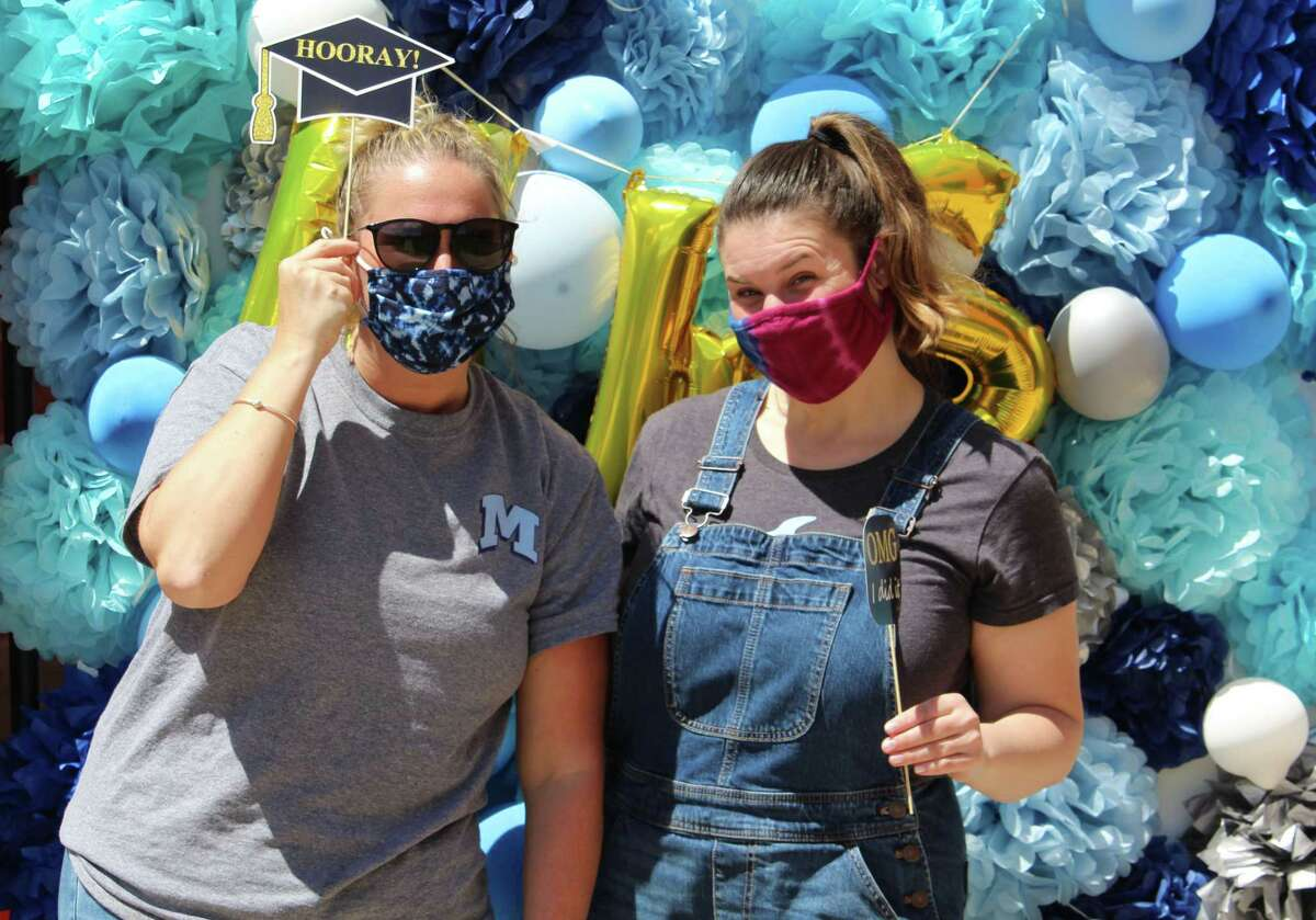Middletown High School seniors enjoyed field day activities Wednesday, which included a photo booth, games, dunk tanks, dancing make-your-own s'mores and dirt cakes, as well as various stations set up on the grounds where they could pot their own succulents, tie dye T-shirts and more.