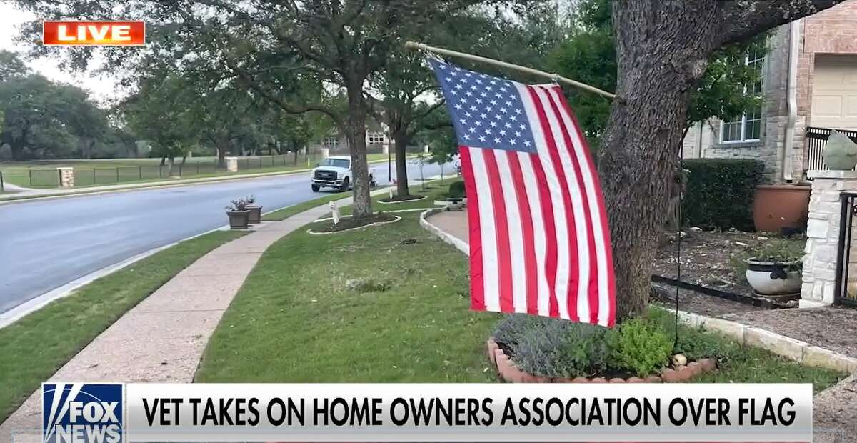 A navy veteran is one of several residents being asked by the Avery Branch Home Owner's Association to change the way they display the American flag in their yard. (Screengrab courtesy of Fox News)
