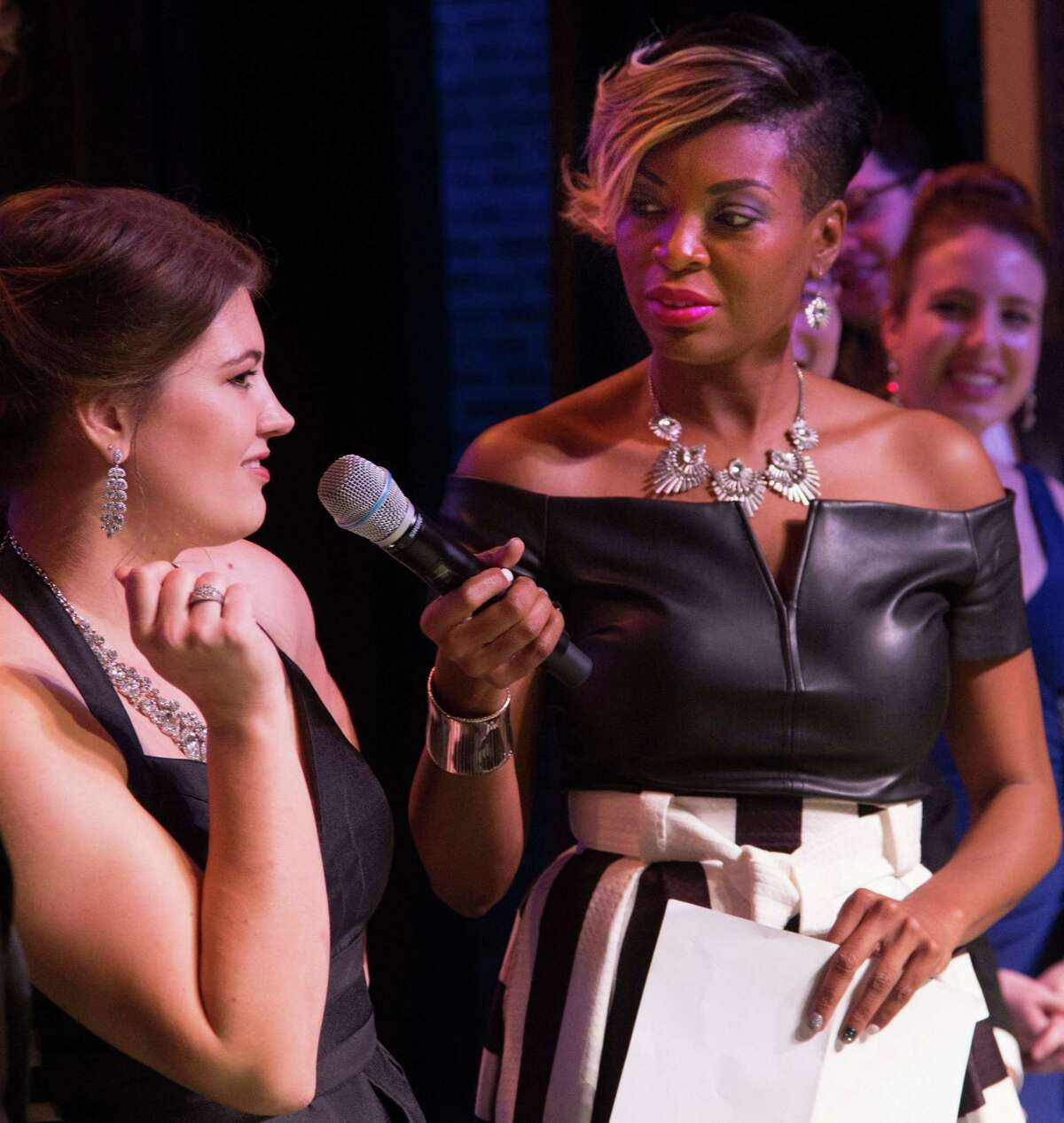 Mezzo-soprano Brennan Blankenship, who later received the gold medal for voice, answers an interview question from Mistress of Ceremonies Jade Simmons during the Young Texas Artists (YTA) 2019 Finalists Concert & Awards. The Silver Linings campaign will support YTA's efforts to provide competition winners cash prizes, performance opportunities and career development programs.