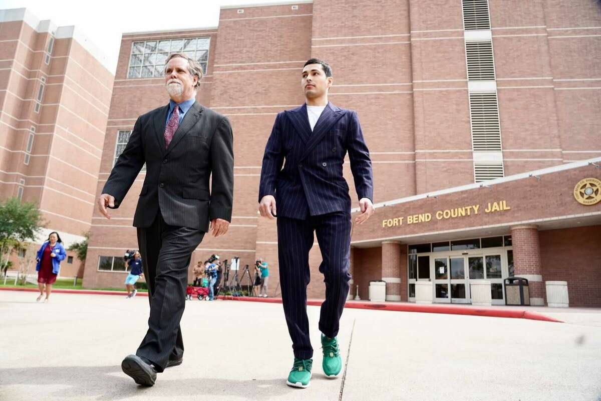Victor Hugo Cuevas, right, and attorney Michael Elliott leave the Fort Bend County jail on Wednesday, May 12, 2021, after the Cuevas posted bond.Cuevas, charged in a 2017 murder, was arrested Monday at his mother's Richmond home after police said he fled a Houston police officer with a tiger seen roaming a west Houston neighborhood. A judge ordered that he be held on a $50,000 bond connected to the Harris County evading arrest case.