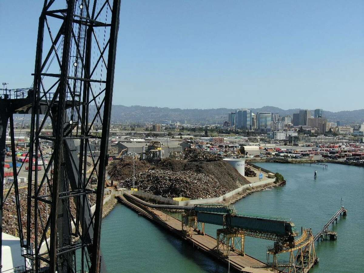 Schnitzer Steel operates 24/7 and is next to the Howard Terminal, background, where condos will be built as part of a proposed Oakland A's Stadium project.