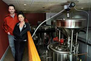 File photo of Rick Cipriani, left, and Wendy Wulkan, right. They were co-owners of the Bull and Barrel Brew Pub in Brewster, N.Y. They are photographed near the brewing tanks Tuesday, March 11, 2014.