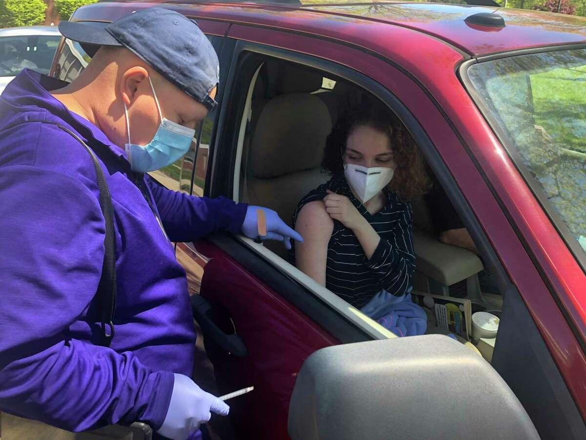 Yarnel Valle prepares to give a dose of the COVID-19 vaccine to Bunnell High School senior Amaya Pemberton during a clinic for students at the school May 12, 2021.