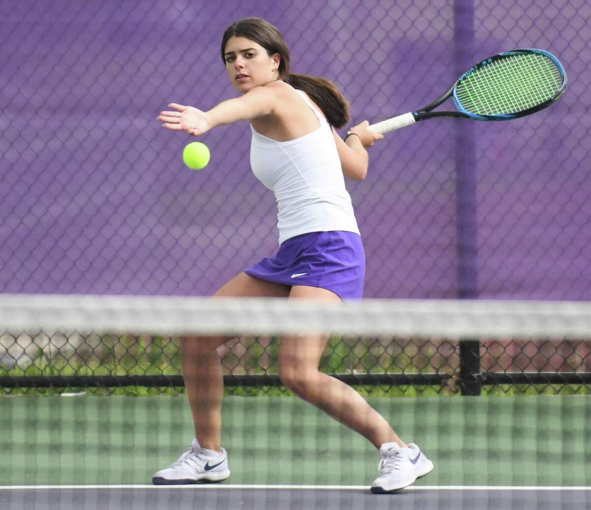 Westhill's Martina Kaba returns a shot during a match against Ridgefield in Stamford on Monday.