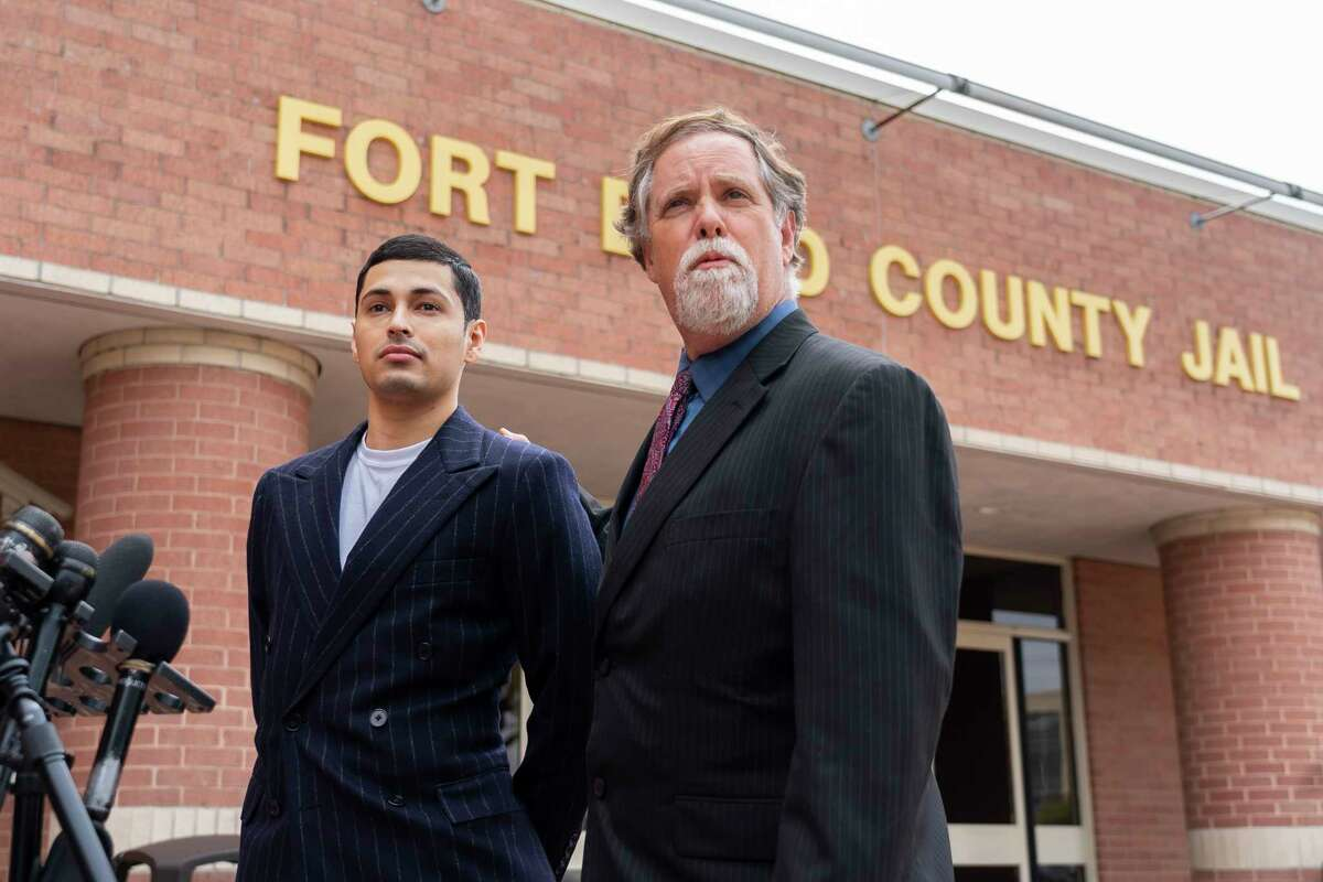 Victor Cuevas appears with his lawyer Michael Elliott after bonding out of jail, Wednesday, May 12, 2021, at the Fort Bend County Jail in Richmond. Cuevas was arrested Monday after fleeing a Houston Police Officer with a missing tiger in west Houston.