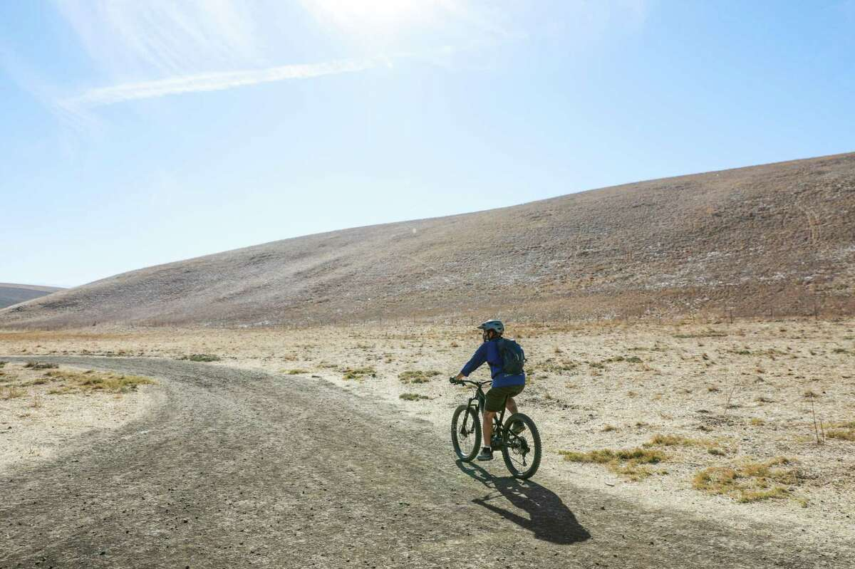 A man bikes on a trail in Brushy Peak Regional Preserve on Monday, Nov. 16, 2020 in Livermore, California.