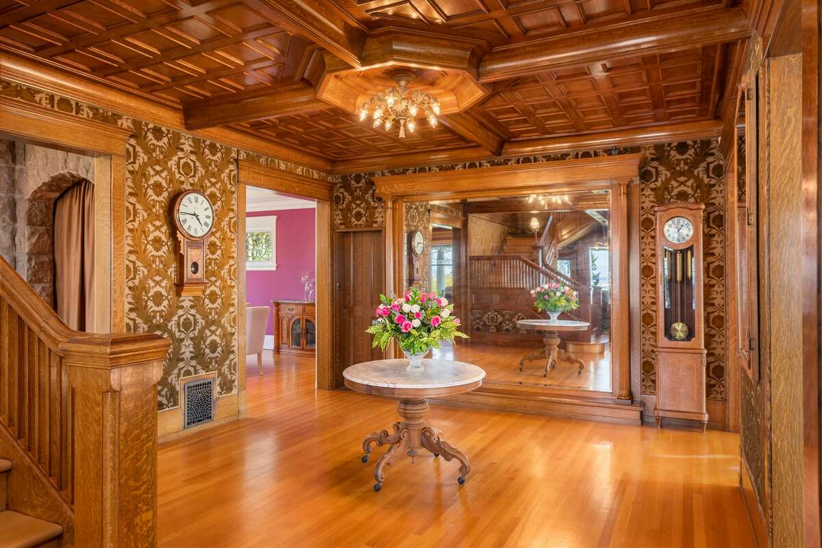 Framed in oak and mahogany, the original velvet and silk coverings from New York's W & J Sloane still decorate the walls of the home's entry room.