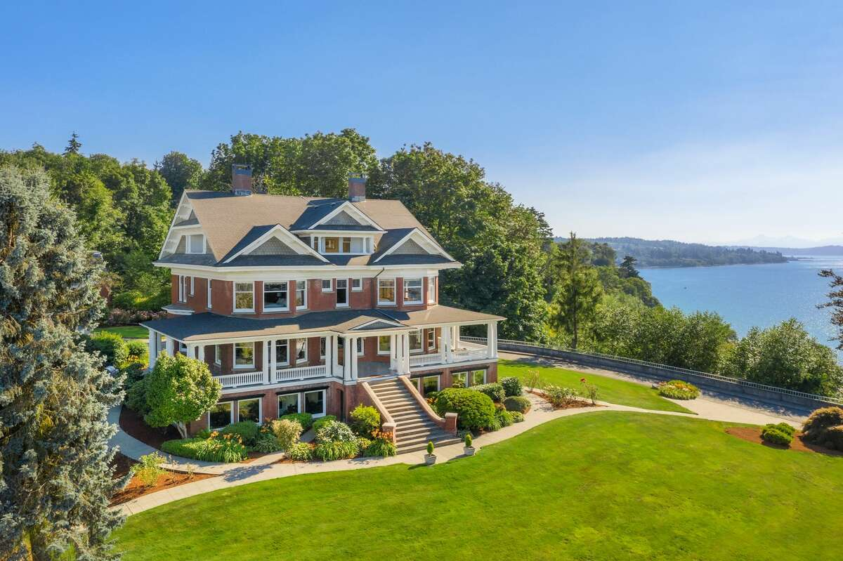The 10,000-square-foot mansion is set on an oversized, two-parcel lot overlooking Port Gardner Bay.