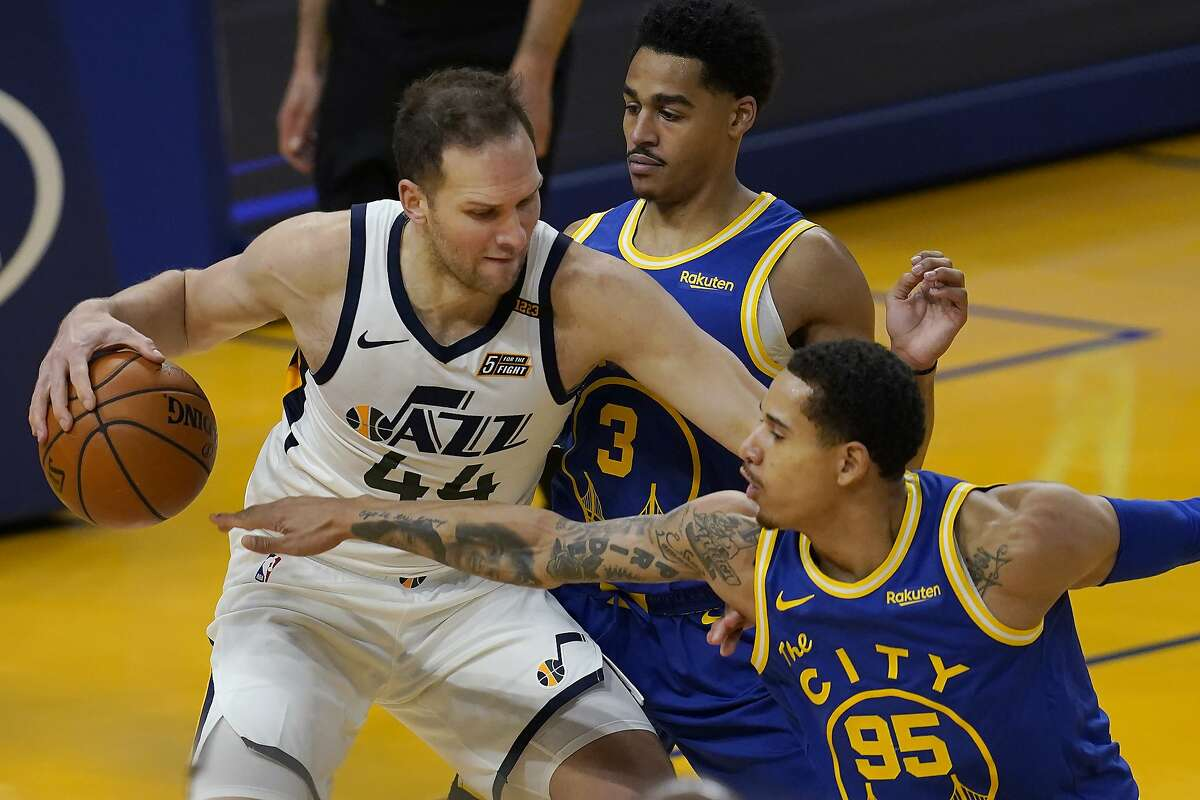 Utah Jazz forward Bojan Bogdanovic (44) is defended by Golden State Warriors forward Juan Toscano-Anderson (95) and guard Jordan Poole (3) during the first half of an NBA basketball game in San Francisco, Sunday, March 14, 2021. (AP Photo/Jeff Chiu)