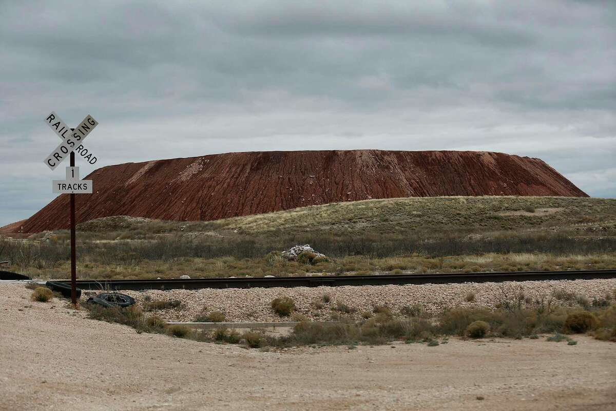 A view of a large mound of Dockum clay, which is used at Waste Control Specialists near Andrews as part of the encasement for spent nuclear waste at its facility. A bill opposed by both environmental and some oil interests that would have given the company a big break on state fees failed to receive a vote in the Texas House before a key deadline this week.