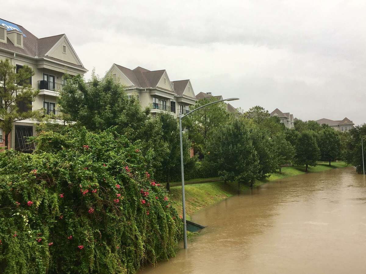Hurricane Harvey devastated Houston and the Kingwood area, which did make changes to help prevent flooding again in the future, but now as individuals and businesses aim to rent or buy property, flooding is considered less important now than factoring in a pandemic. Pictured: Memorial Drive is flooded in central Houston after the Buffalo Bayou swelled during intense rains from Hurricane Harvey, Aug. 27, 2017.