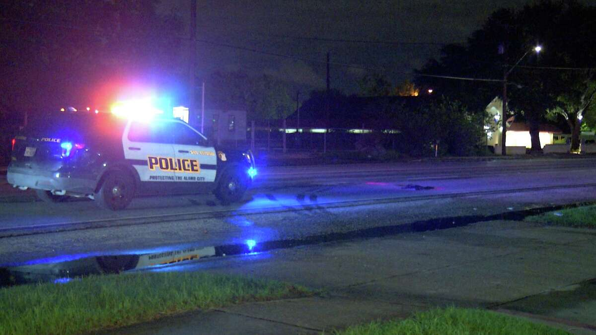 San Antonio police examine the scene where a woman was fatally struck by a truck about 9:30 p.m. Tuesday in the 2000 block of South W.W. White Road.