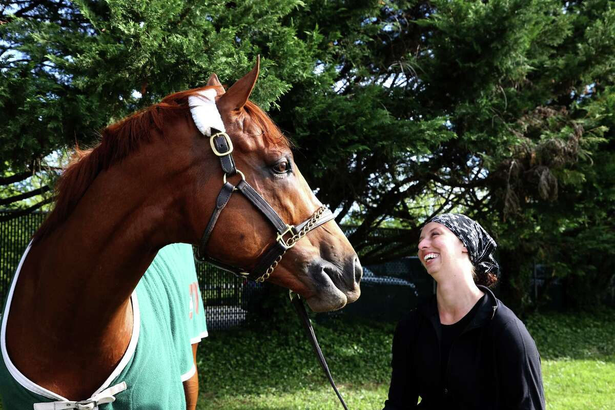 Exercise rider Jade Cunningham holds Preakness entrant Ram outside the barn following a training session for the upcoming Preakness Stakes at Pimlico Race Course on May 12, 2021, in Baltimore.