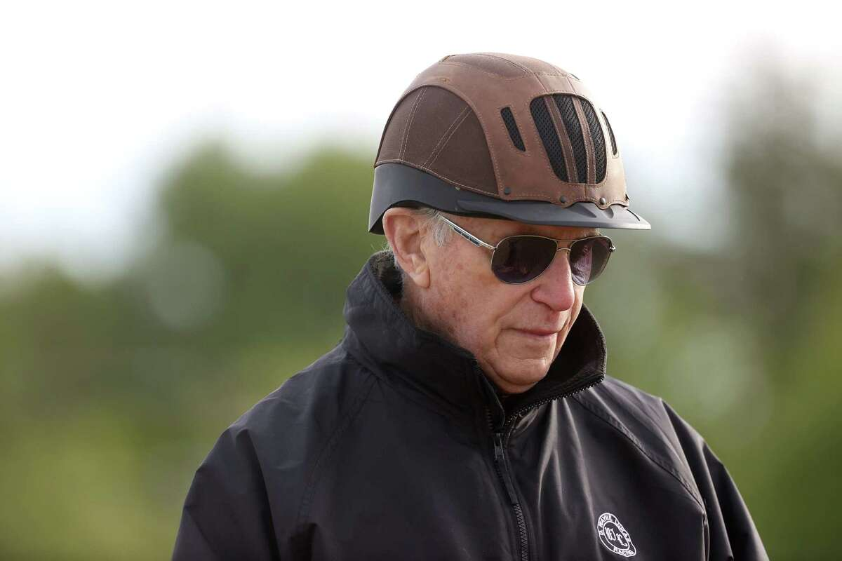 Hall of Fame trainer D. Wayne Lukas looks on as his horse Ram trains on the track for the upcoming Preakness Stakes at Pimlico Race Course on May 12, 2021, in Baltimore.