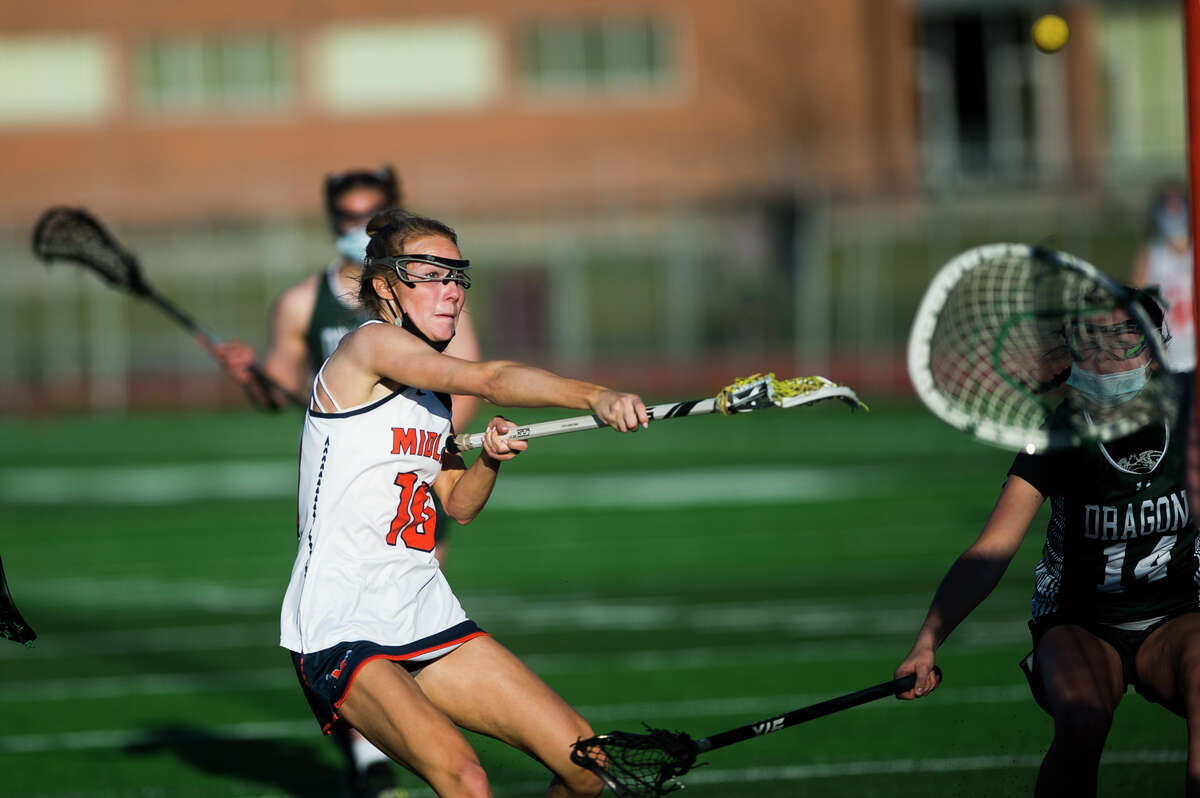 Midland's Emma Murphy takes a shot on goal during a game against Lake Orion Wednesday, May 12, 2021 at Midland Community Stadium. (Katy Kildee/kkildee@mdn.net)