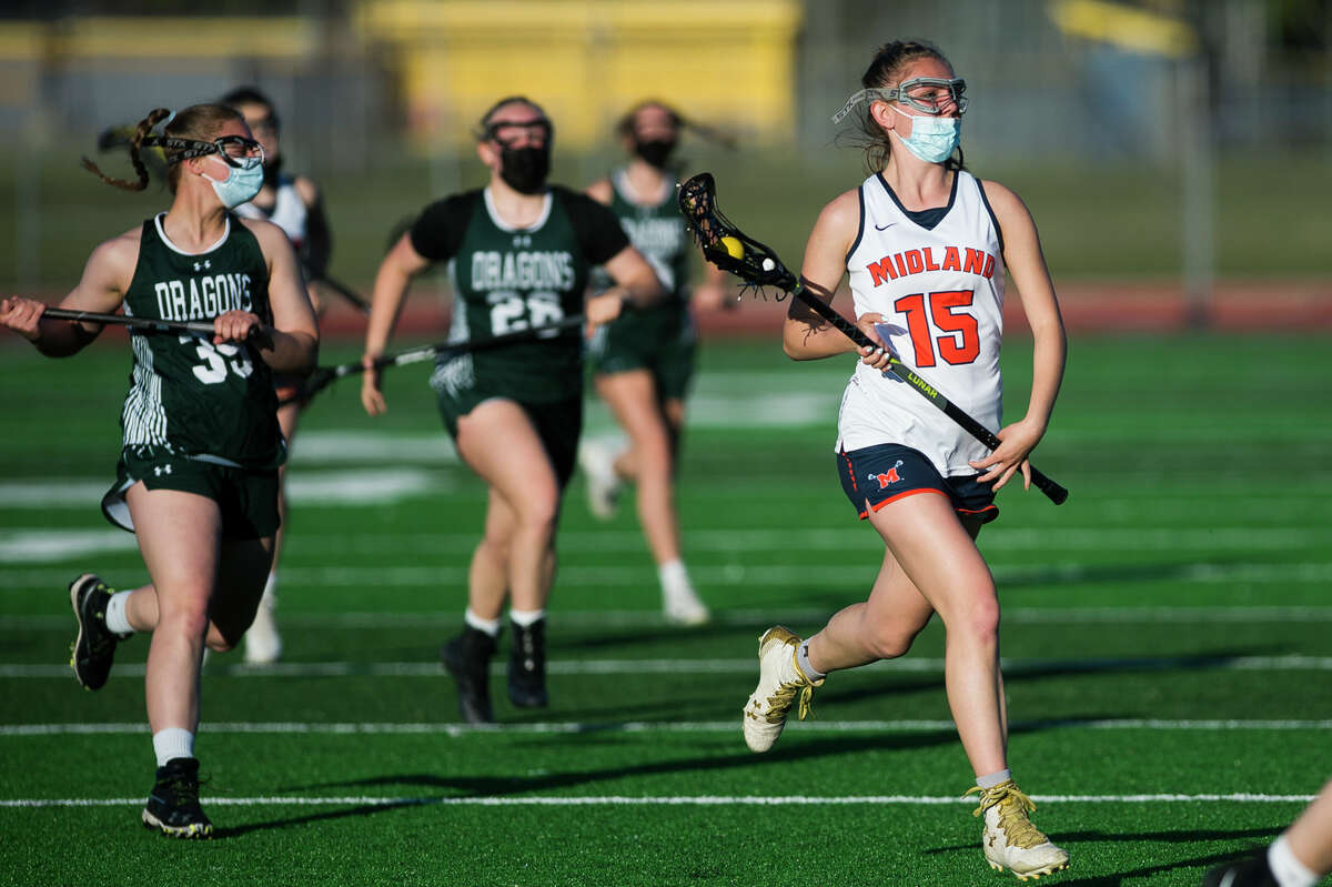 Midland's Renee Mulvaney moves the ball down the field during a game against Lake Orion Wednesday, May 12, 2021 at Midland Community Stadium. (Katy Kildee/kkildee@mdn.net)