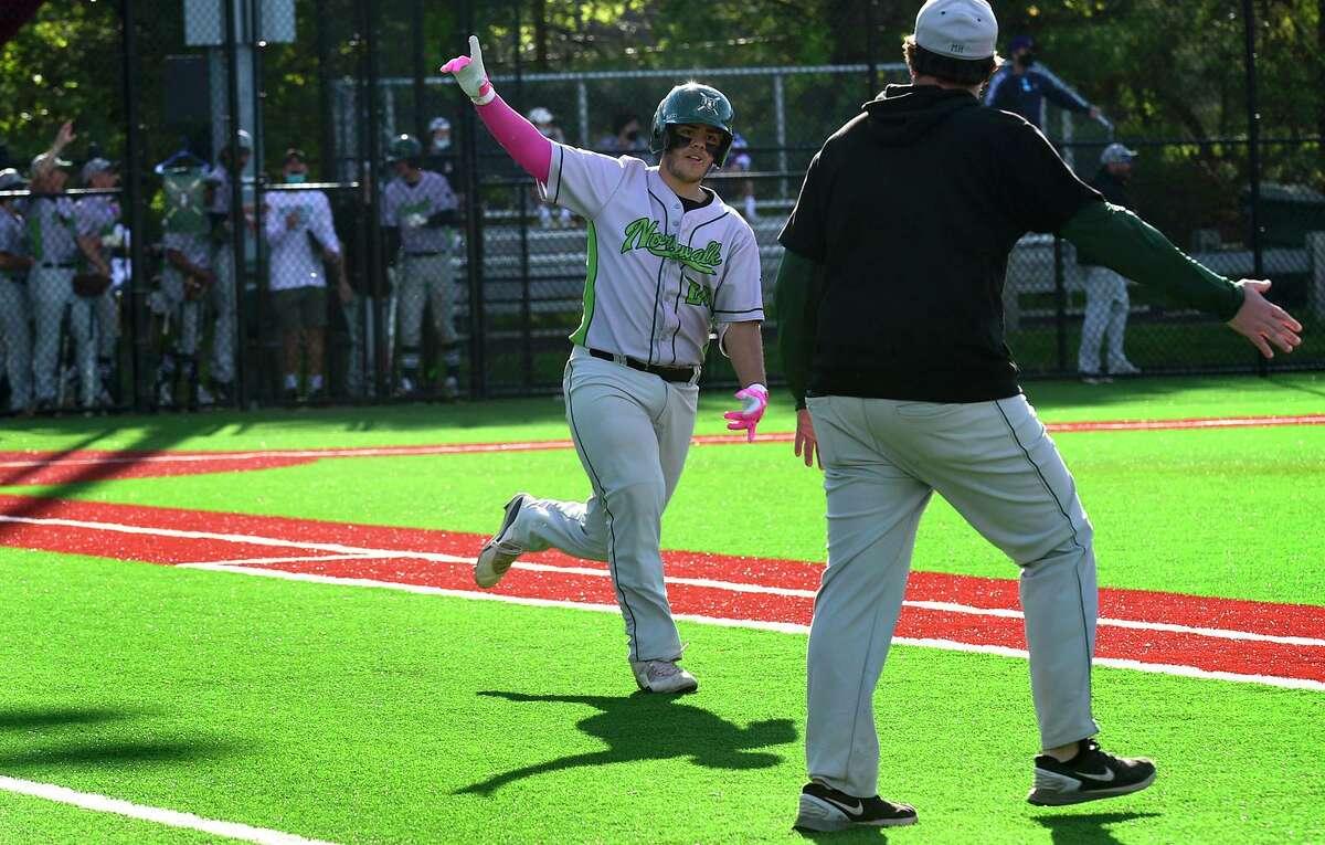 Jaden Echevarria signals his home run as the Norwalk Bears take on the Brien McMahon Senators in their FCIAC baseball game on Wednesday at BMHS in Norwalk. Norwalk won 13-5.