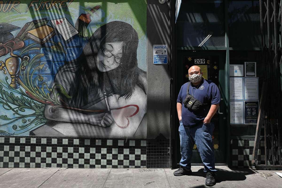 Director Michael Vuong outside the Teen Center, part of the Tenderloin Clubhouse campus in San Francisco.