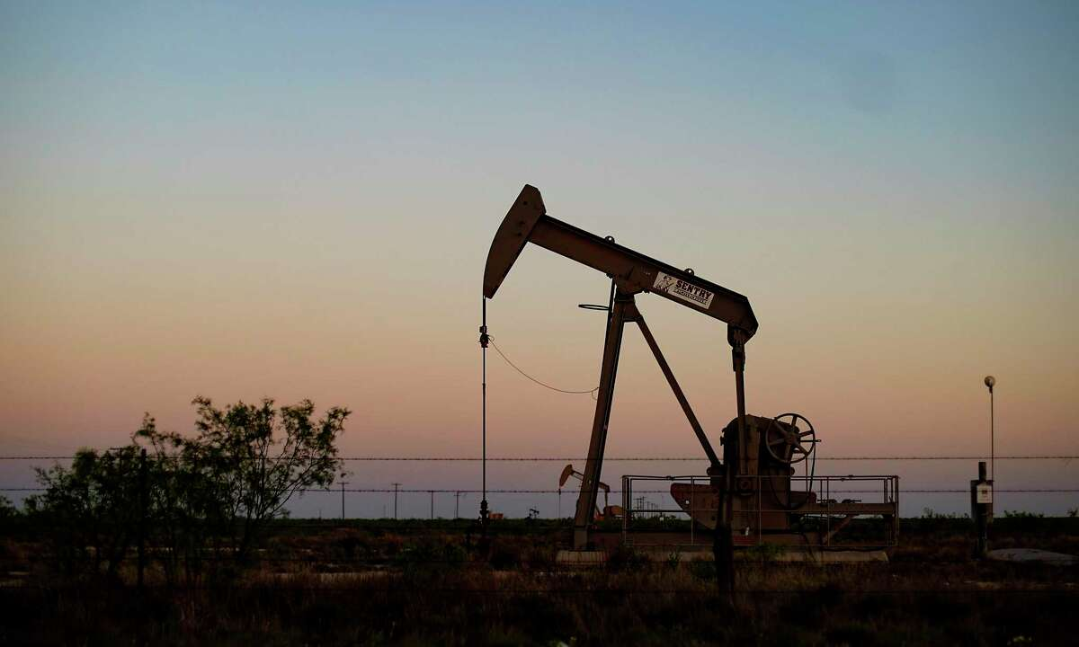 An oil pump jack outside of Odessa. Oil companies are unlikely to restore steep cuts to their exploration and production budgets even as they recover from the worst oil bust in decades, according to a new report.