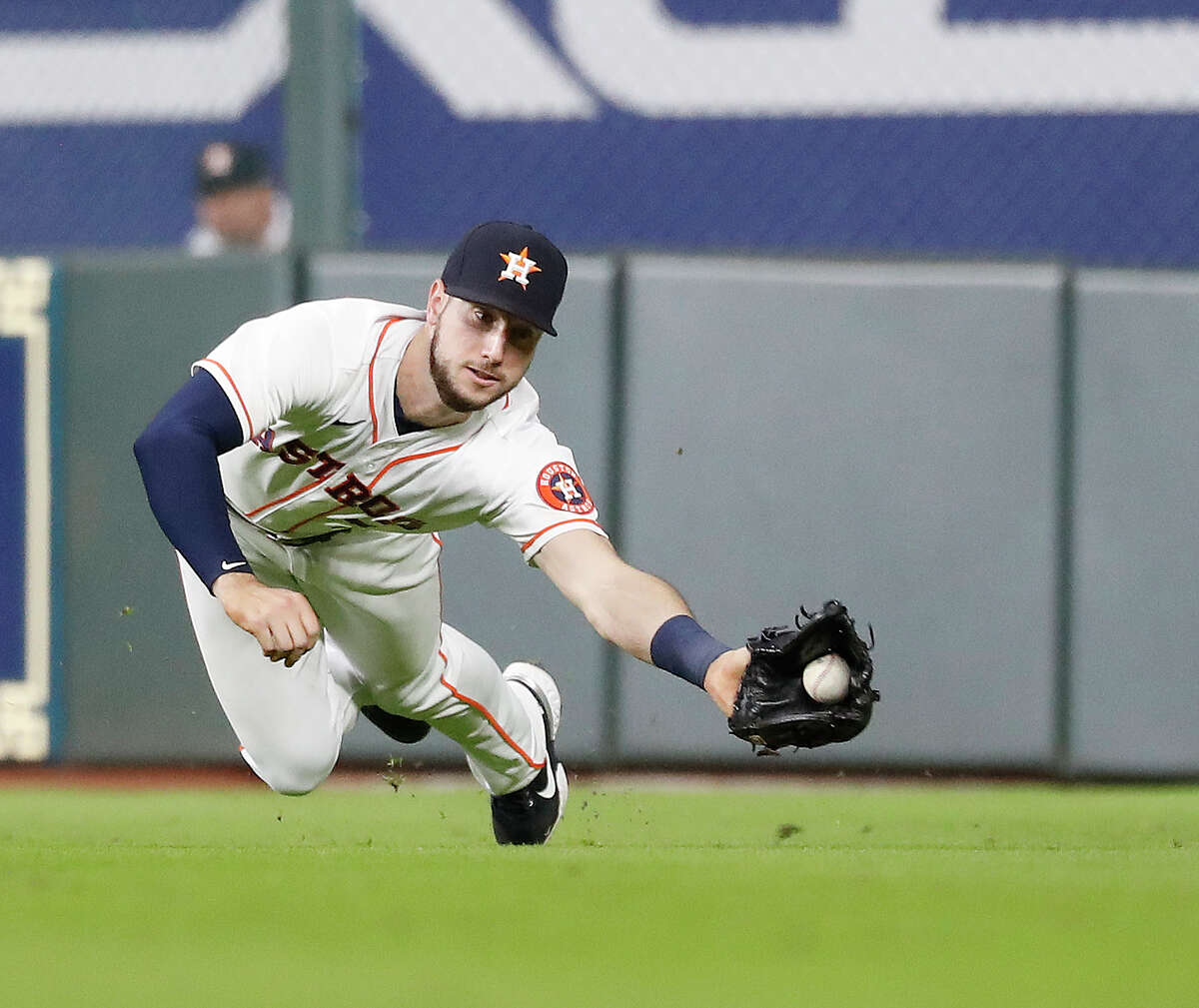 Astros right fielder Kyle Tucker makes a diving catch on Jared Walsh's line drive during the fourth inning of Wednesday's victory at Minute Maid Park.