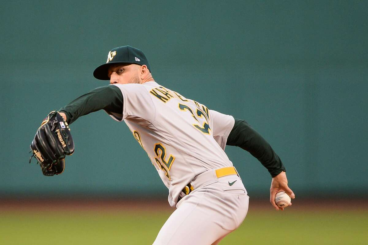 The A's James Kaprielian pitches in the first inning against the Boston Red Sox at Fenway Park on Wednesday.