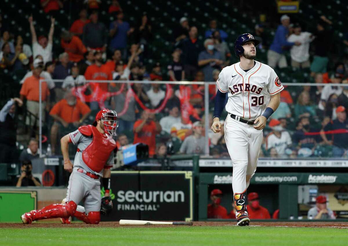 Astros right fielder Kyle Tucker watches his home run go over the fence during the sixth inning of Wednesday's win over the Angels.