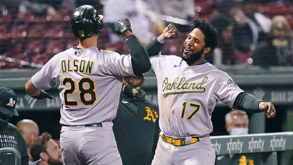 A's first baseman Matt Olson is congratulated by teammate Elvis Andrus after hitting a solo home run off Red Sox starter Eduardo Rodriguez in the sixth inning at Fenway Park.