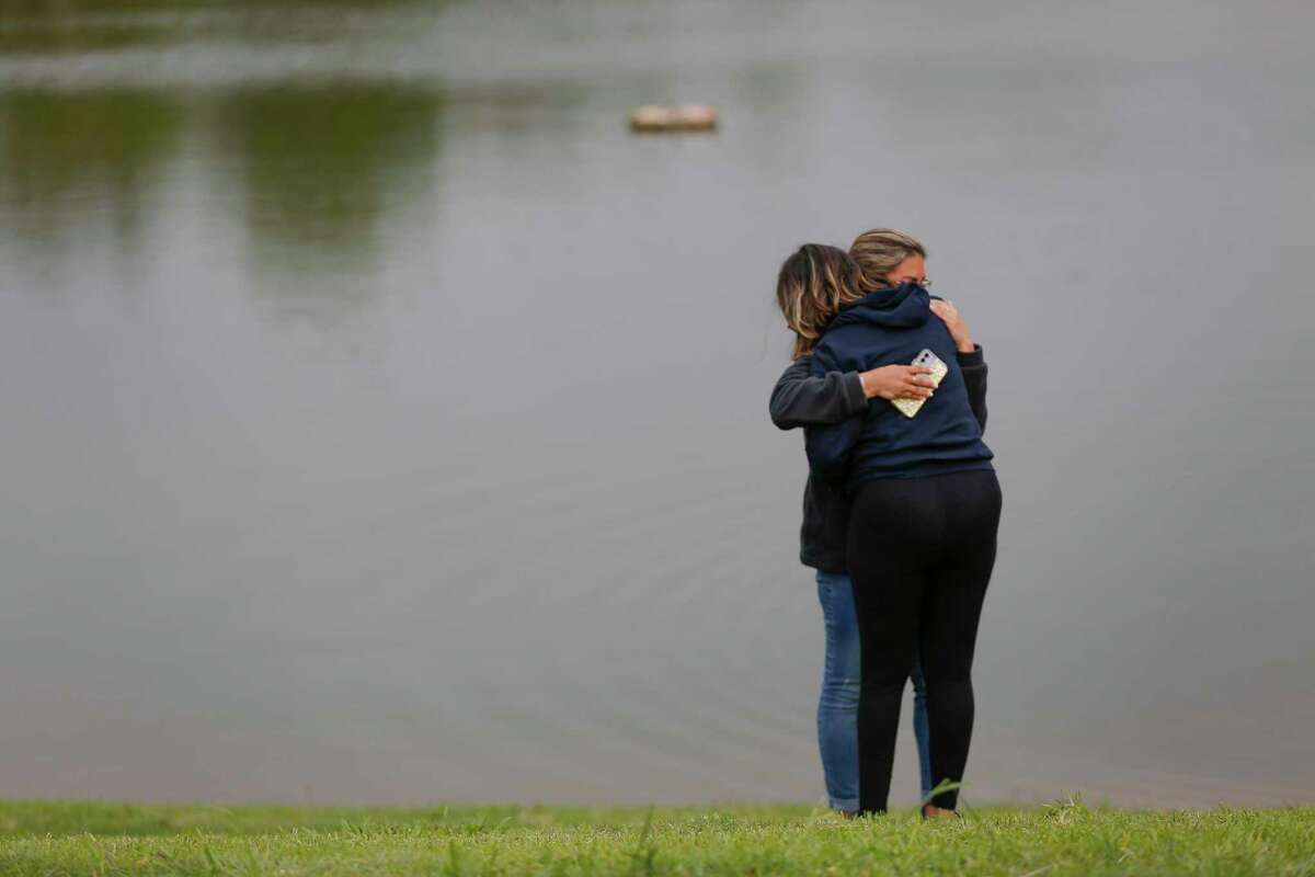 Erica Hernandez' cousins, Lisa Loredo (facing) receives a hug from her daughter, Desiree, before a press conference at the site where her body was found in a submerged SUV Wednesday, May 12, 2021, in Pearland.