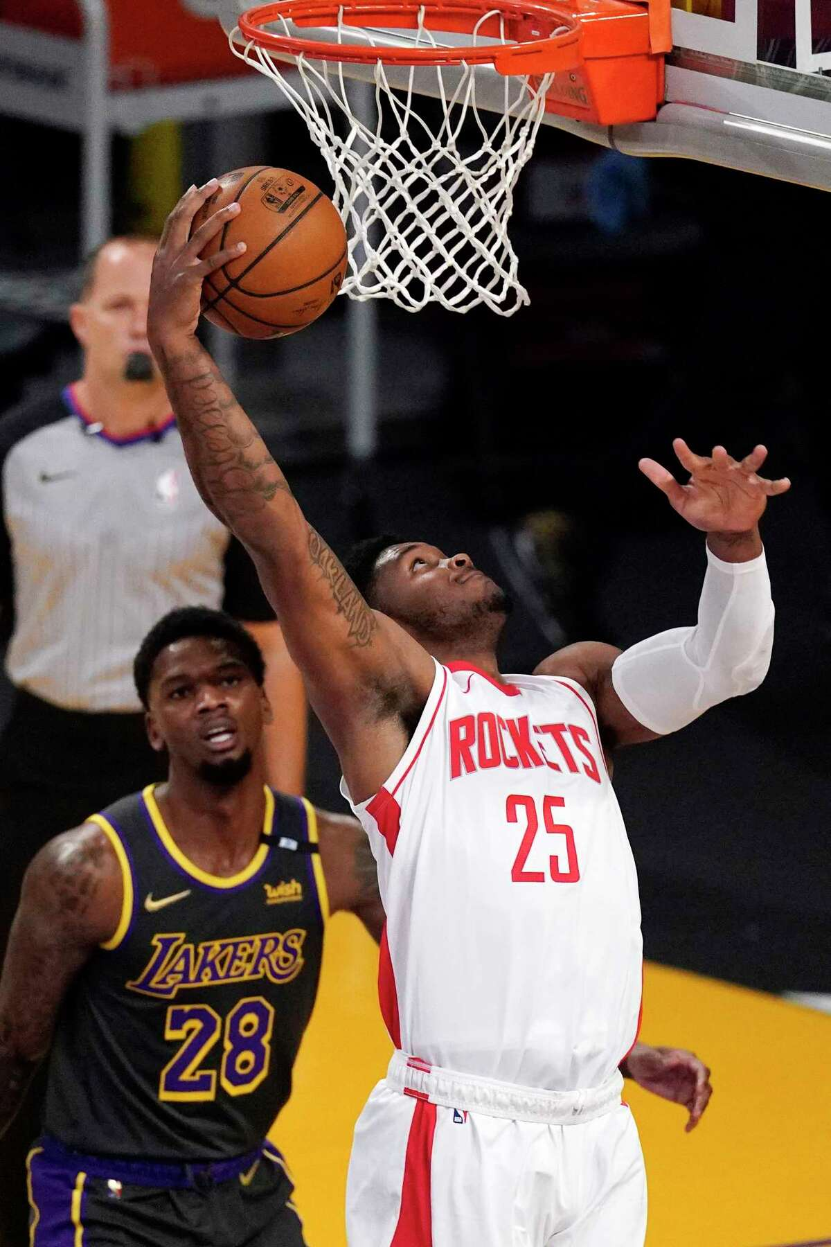 Houston Rockets forward Cameron Oliver shoots as Los Angeles Lakers forward Alfonzo McKinnie watches during the first half of an NBA basketball game Wednesday, May 12, 2021, in Los Angeles. (AP Photo/Mark J. Terrill)