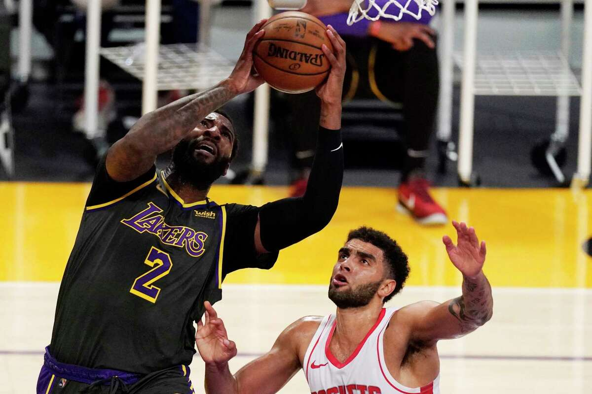 Los Angeles Lakers center Andre Drummond, left, shoots as Houston Rockets forward Anthony Lamb defends during the first half of an NBA basketball game Wednesday, May 12, 2021, in Los Angeles. (AP Photo/Mark J. Terrill)